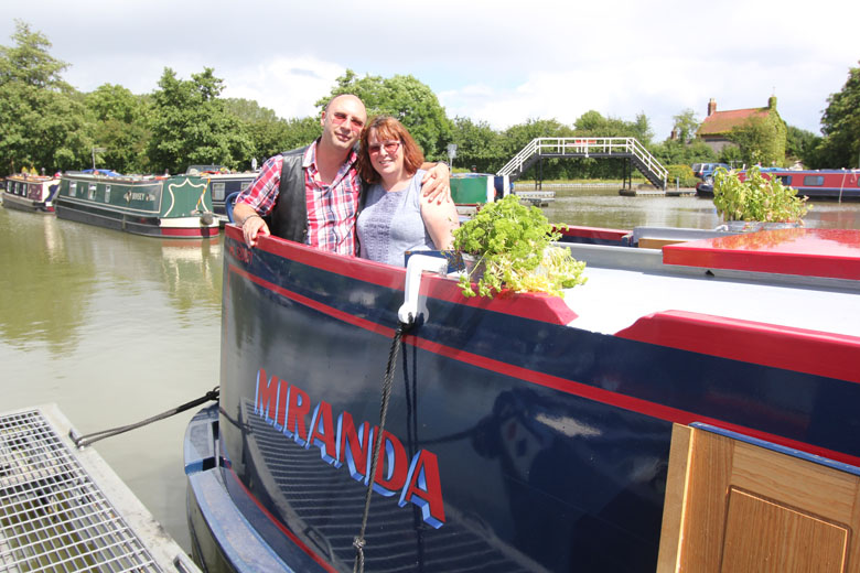 Sue-and-Nigel-Gray-aboard-their-newly-purchased-canal-boat-Miranda